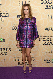 Alysia Reiner chose a pair of purple platform sandals to finish off her look.