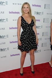 Ali Larter paired her playful polka dot frock with navy patent pumps.