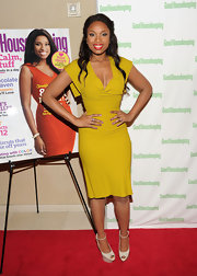 Jennifer Hudson accessorized her saffron-colored frock with cream peep-toe pumps.