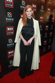 Sarah Rafferty topped off her look with a cream-colored coat.