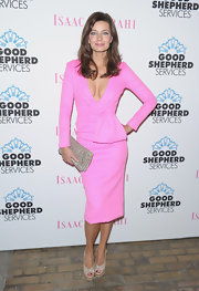 Paulina Porizkova paired  shiny champagne heels with her stunning pink suit for the Good Shepherd Services spring party.