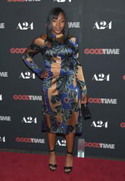 Taliah Webster completed her look with black ankle-strap platforms.