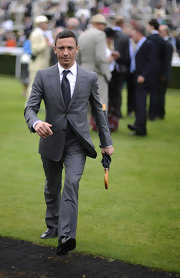 Frankie Dettori oozed elegance in his handsome gray suit.