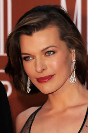 Milla Jovovich paired her elegant look with sparkling diamond drop earring.