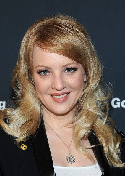 Wendi McLendon-Covey wore her long hair in softly tousled curls with sexy side-swept bangs at a press conference for 'Got Your 6.'