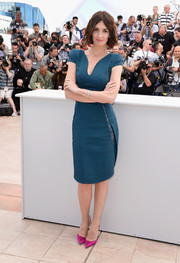 Paz Vega's magenta Louboutin Iriza pumps contrasted wonderfully with her teal dress.