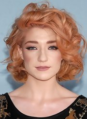 Nicola opted for high drama with wispy false lashes and voluminous curls.