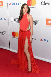 Hailee Steinfeld flaunted her slim figure in a red cutout bodysuit by Elie Saab at the Grammy Salute to Industry Icons.