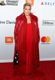 Pink arrived for the Grammy Salute to Industry Icons looking regal in a red fur coat.