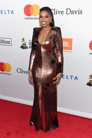 Jennifer Hudson brought some sexy shimmer to the Grammy Salute to Industry Icons with this body-con bronze sequin gown by Rubin Singer.