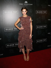 Katie Holmes looked summery in a ruffled print dress by Ulla Johnson at the grand opening of Black Tap Craft Burgers & Beer.