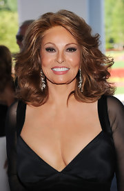 Raquel Welch looked great with her locks styled in feathered flip curls for the grand opening of The Casino Club.