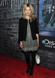 Clemence Poesy looked sleek in black platform pumps teamed with matching opaque tights.