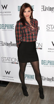 Jessica tones down her little black skirt with a red-and-blue plaid shirt.