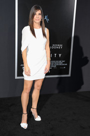 Sandra Bullock polished off her look with a pair of embellished black-and-white sandals by Giuseppe Zanotti.