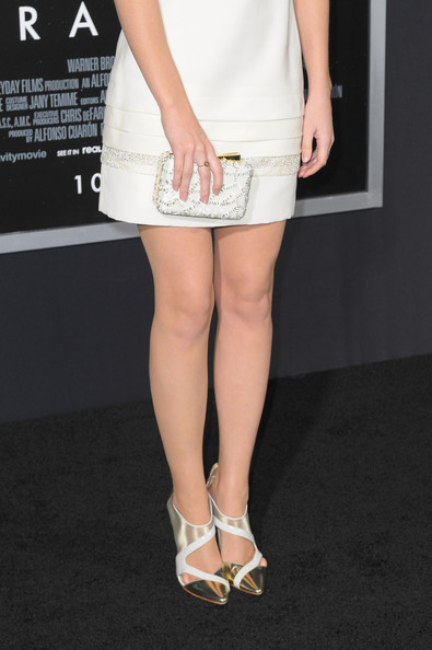 A pair of metallic cutout pumps infused a futuristic vibe into Emma Watson's look during the 'Gravity' premiere.