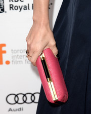 Jennifer Morrison added a touch of feminine color to her ensemble with this pink hard-case clutch when she attended the premiere of 'Gravity.'