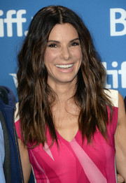 Sandra Bullock looked mildly punky with this center-parted wavy 'do during the 'Gravity' press conference.