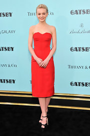 Carey Mulligan kept her look simple and iconic with a strapless red corset dress that featured a structured bodice.