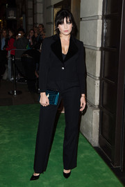 Daisy Lowe went conservative in a plain black suit for the Green Carpet Challenge BAFTA Night.