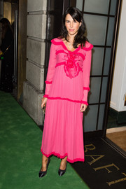 Caroline Sieber looked striking in a loose fuchsia frock at the Green Carpet Challenge BAFTA Night.