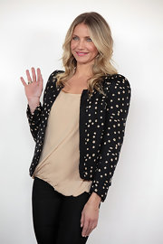 Cameron wears a sweetly embellished blazer with this chic style.