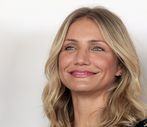 Actress Cameron Diaz attended 'The Green Hornet' photo call wearing a pair of 18-karat yellow gold spike stud earrings.