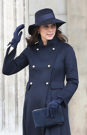 Kate Middleton kept warm in sweet style with a pair of bow-adorned merino wool gloves by Cornelia James.