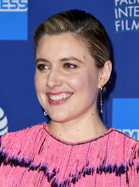 Greta Gerwig Classic Bun [hair,face,hairstyle,eyebrow,chin,forehead,smile,pixie cut,eyelash,electric blue,arrivals,greta gerwig,palm springs convention center,california,palm springs international film festival film awards gala,greta gerwig,2020 palm springs international film festival,marriage story,celebrity,palm springs,actor,film director,film festival,entertainment,palm springs international film festival]