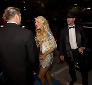 Gretchen Rossi accented her glitzy mini dress with a pearly oversize clutch.