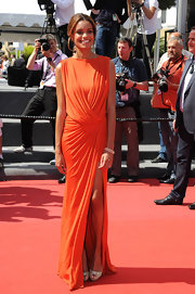 Anais Monory's burnt orange draped dress looked simply gorgeous on her long and lean frame.