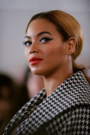 Beyonce wore a vibrant orange-red lipstick with a glossy finish at the groundbreaking ceremony of the Barclays Center at Atlantic Yards in NYC.