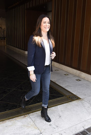 For her footwear, Holly Marie Combs went edgy with black moto boots.