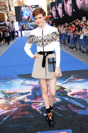 A pair of black patent leather boots with strappy accents finished off Karen Gillan's all-LV ensemble.