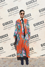 Caroline Issa attended the Gucci Spring 2018 show wearing a loose floral frock from the label.