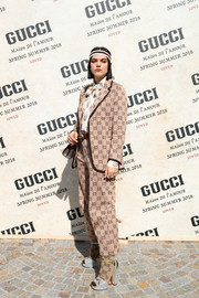 SoKo showed some Gucci love with this beige logo pantsuit during the brand's Spring 2018 show.