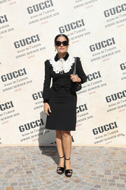 Salma Hayek donned a Gucci LBD with contrast bib detailing for the brand's Spring 2018 show.