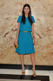 Giovanna Battaglia donned a bright blue blouse, styled with gold accessories, for the Gucci beauty launch event.