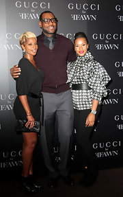 Savannah wore a herringbone silk blouse with black pants and a sleek updo for the Gucci Cocktail Party.