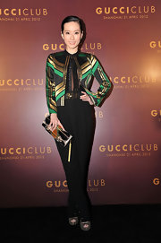 Yvonne Lim carried this artistic clutch with her polished ensemble at the Gucci fashion show in Shanghai.