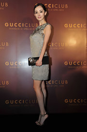 Yang Mi carried this black clutch with metal applique to match her beaded dress at the Gucci fashion show after-party.