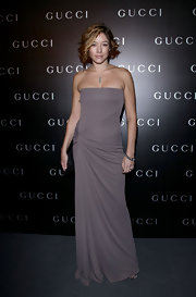 Sarah went for understated glamour at a Gucci dinner in Rome in this strapless, softly-ruched gown.