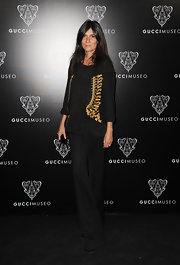 Emmanuelle Alt wore a cropped blazer with gold embroidery at the Gucci Museum opening in Florence.