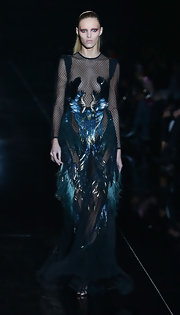 Anja Rubik left little to the imagination in a sheer black evening dress with feather embellishments.