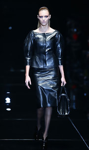 Anja Rubik walked the Gucci runway looking fierce in black leather separates.