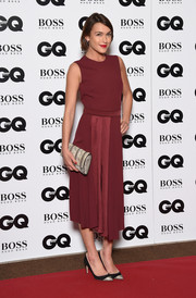 Ella Catliff styled her dress with black and silver cap-toe pumps.