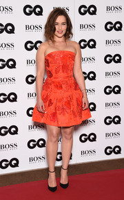 Emilia Clarke was pretty as a picture in an embellished orange strapless dress by Oscar De La Renta at the GQ Men of the Year Awards.