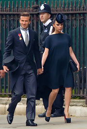 Victoria looked chic in a black shift dress and decorative hat for the royal wedding.
