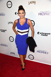 Eva Longoria looked ageless in a tight-fitting tricolor dress during the screening of 'Kahlil Gibran's The Prophet.'