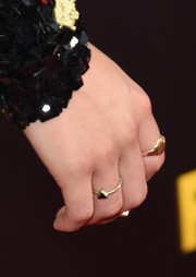 Kristen Stewart accessorized with a simple triangular gold ring by Karen London at the premiere of 'American Ultra.'